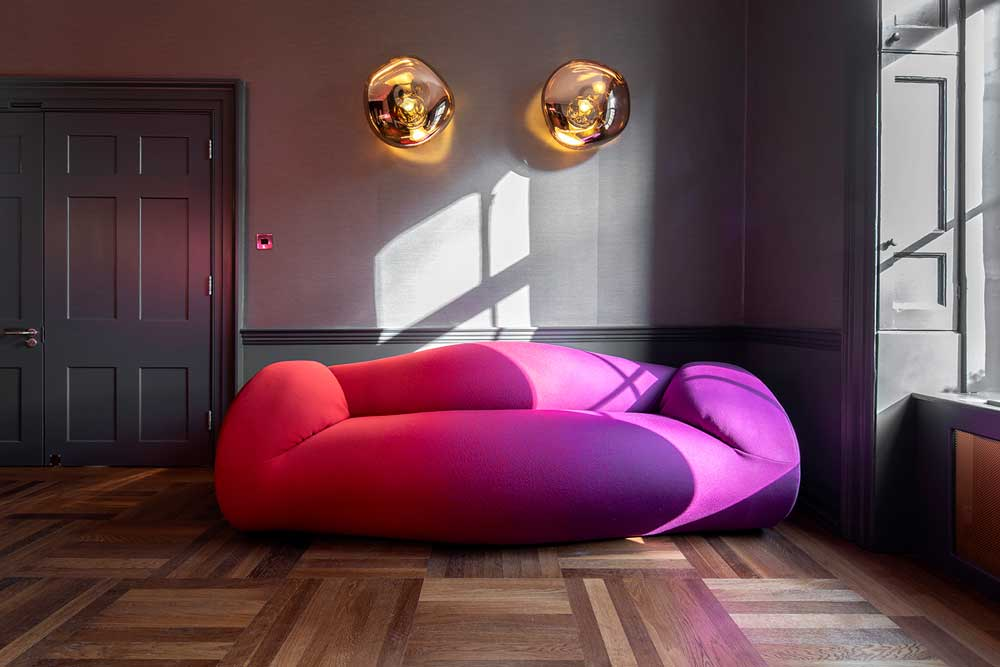 boutique workplace company large red and purple sofa soho square